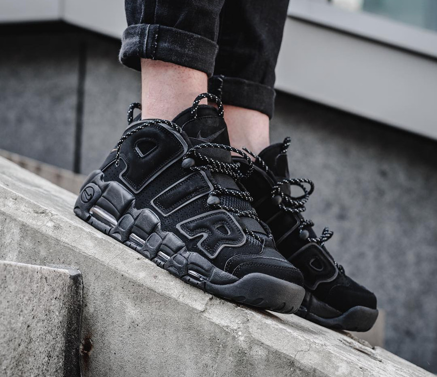 Nike Air More Uptempo QS Noire Triple Black 3M Reflective Laces on feet (2)