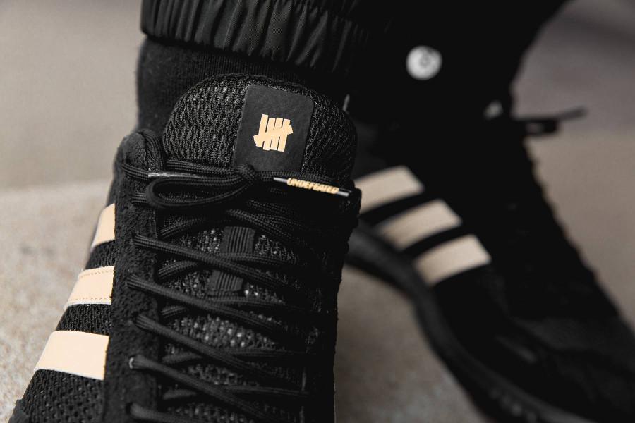 Basket UNDFTD x Adidas Adizero Adios noire on feet B22483 (1)