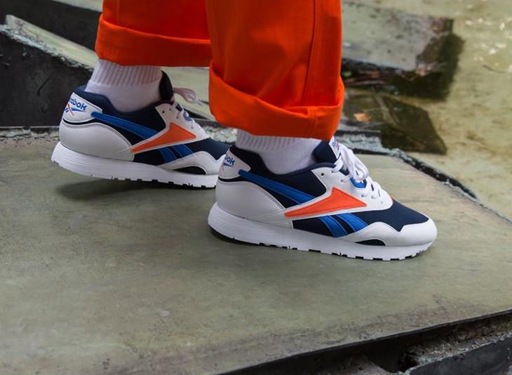 brand new fa2d5 f8618 reebok-classics-rapide-mu-blanche-bleu-et-orange-