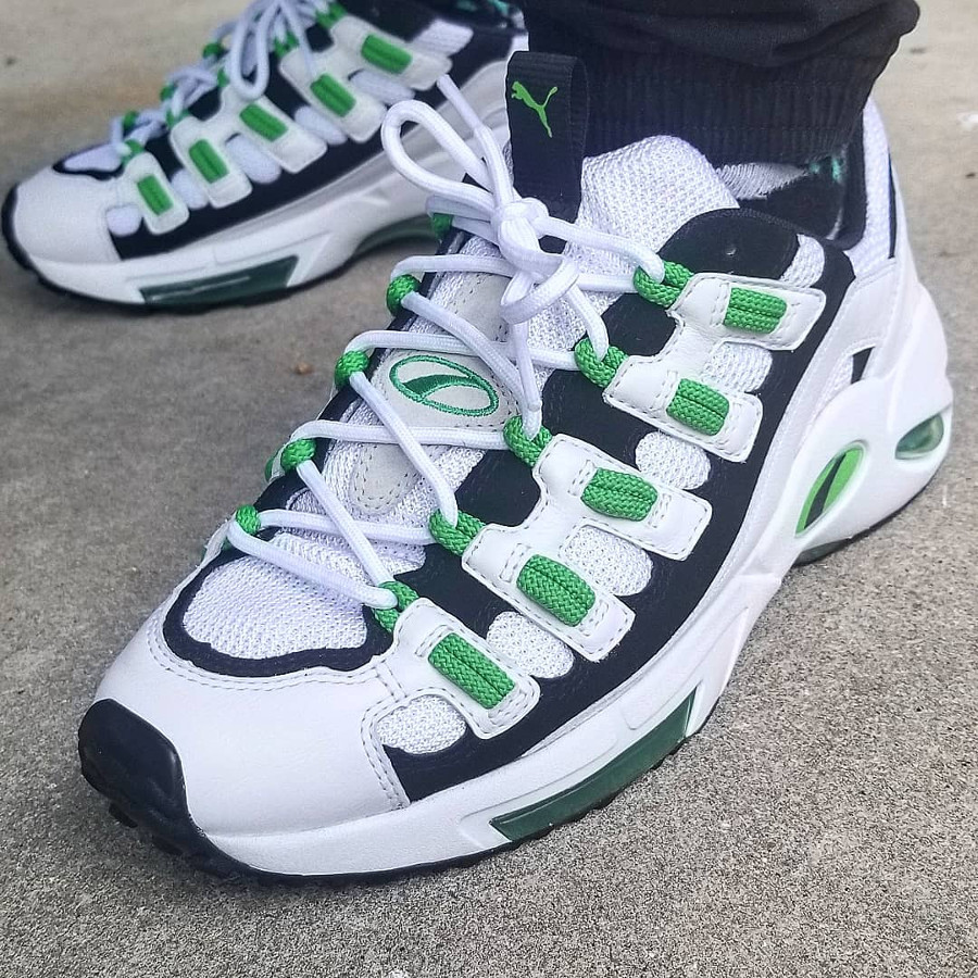 puma-cell-endura-blanc-et-vert-fluo-on-feet-369357-01 (1)