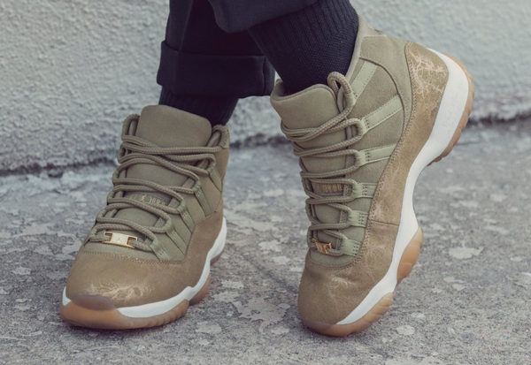 Air Jordan XI luxe en daim vert olive on feet (couv)