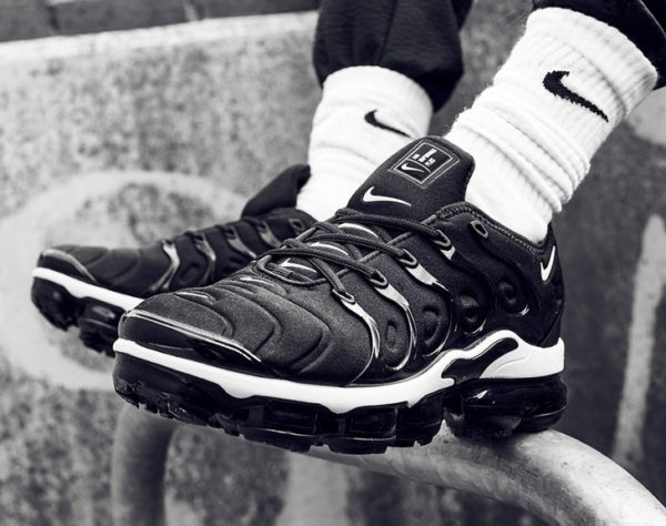 Nike Air Vapormax Plus Black Branded Multiple Swoosh on feet