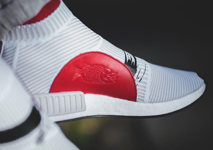 adidas-nmd-cs1-blanche-avec-un-soleil-rouge-3