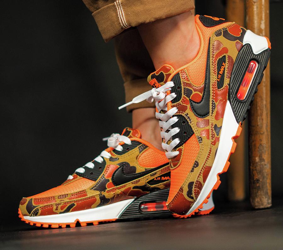 Nike Air Max 90 Premium Orange Duck Camo on feet (3)