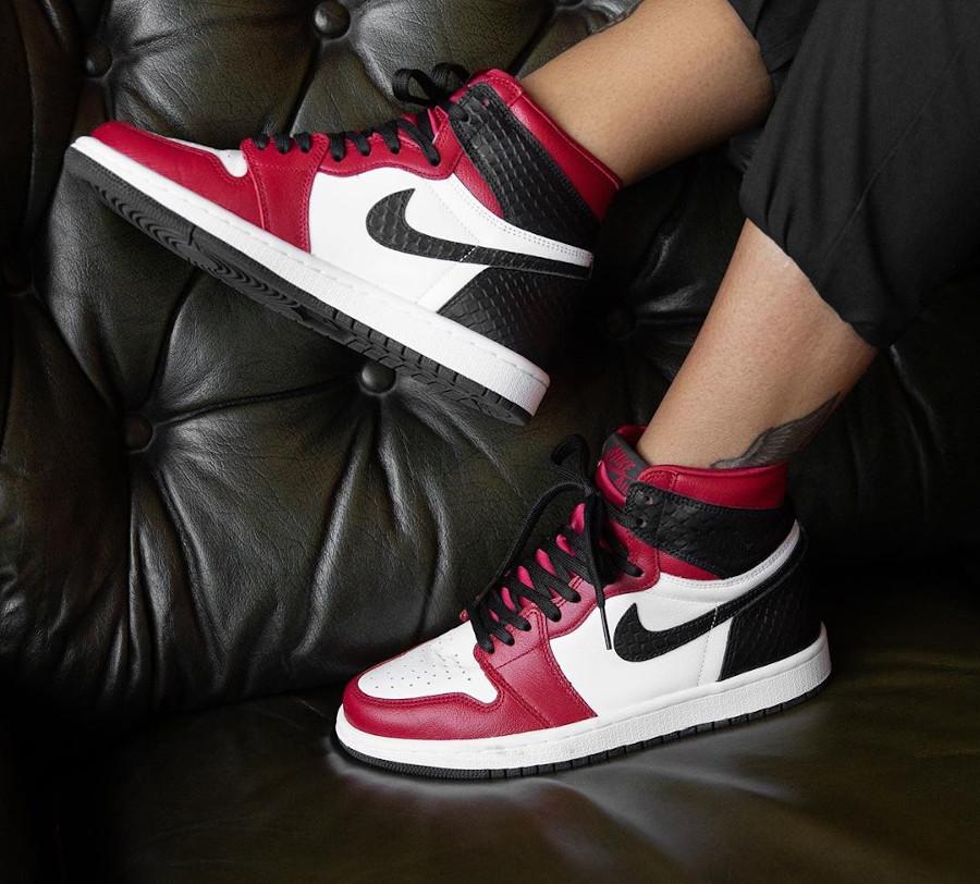 Air Jordan 1 High OG Chicago Satin Snake on feet (1)