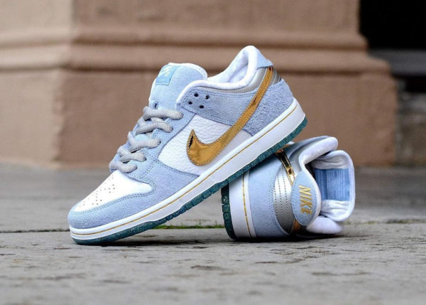 Nike SB x Sean Cliver Dunk Low Pro Holiday DC9936-100