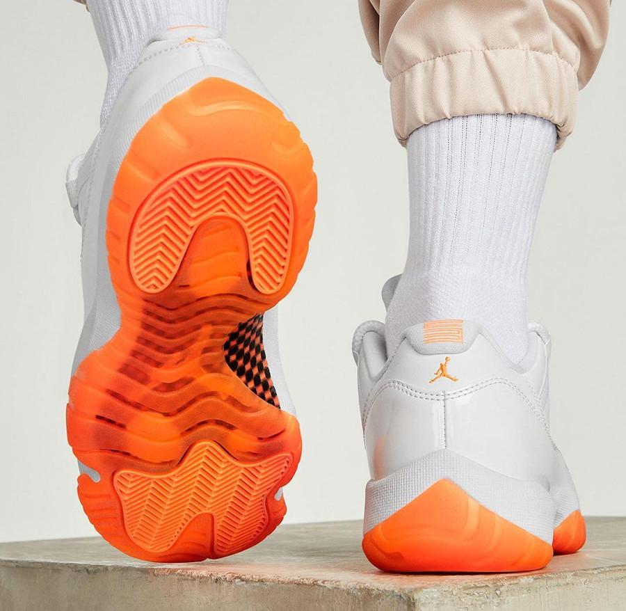 AJ11 Low blanche et orange on feet