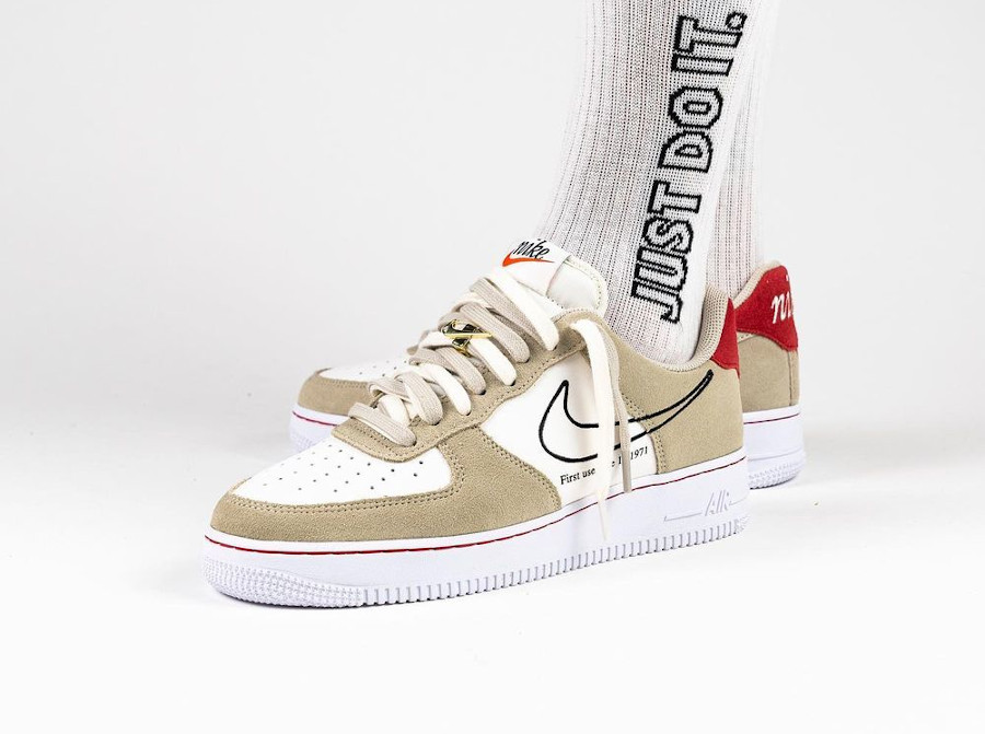Nike AF1 First Use Light Stone Sail Red 50th Swoosh on feet DB3597-100