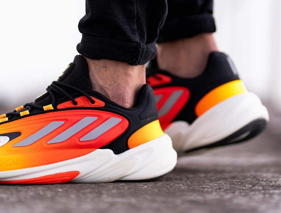 Adidas Ozelia noire jaune et orange on feet (1-1)