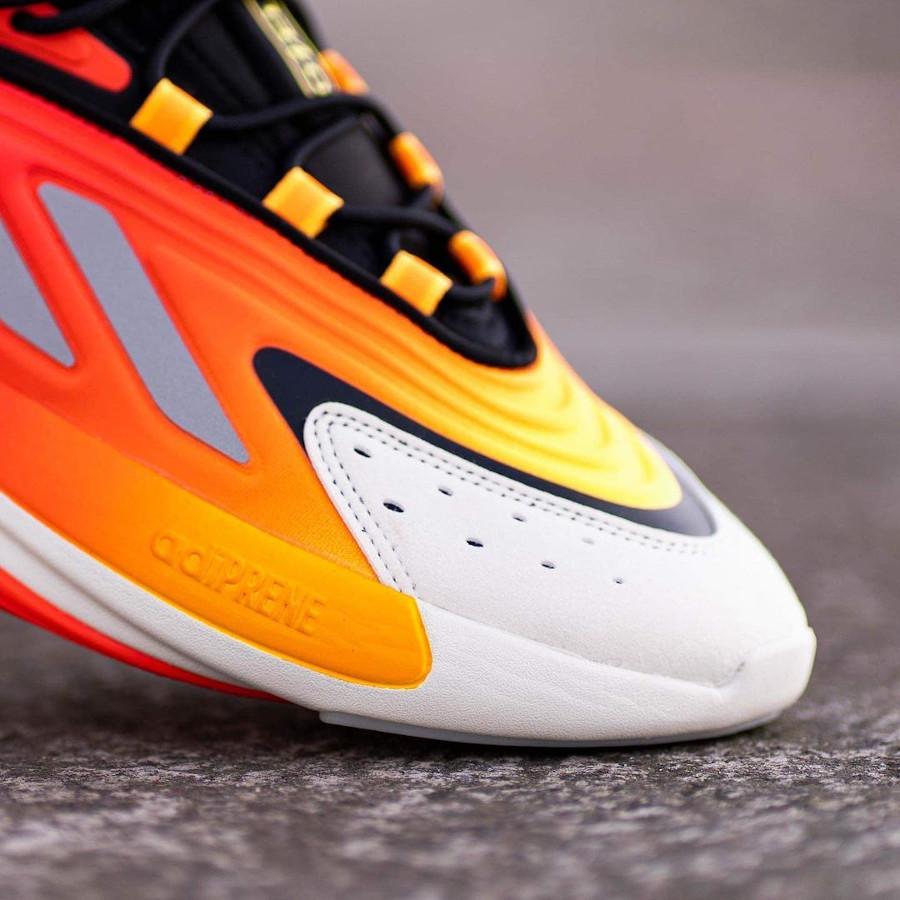 Adidas Ozelia noire jaune et orange on feet (2)