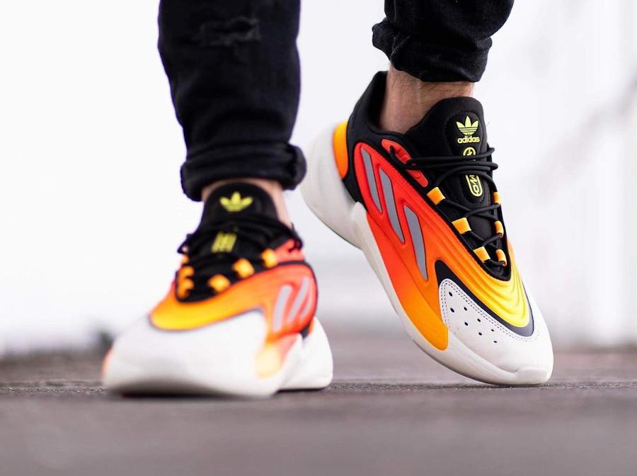 Adidas Ozelia noire jaune et orange on feet (4)