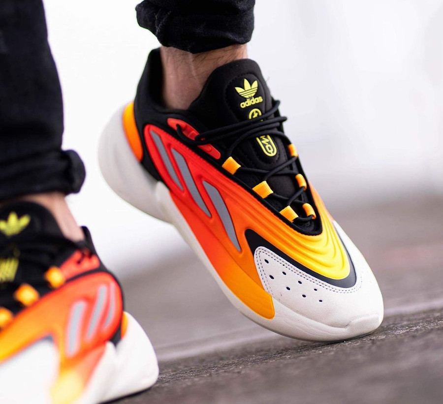 Adidas Ozelia noire jaune et orange on feet (6)
