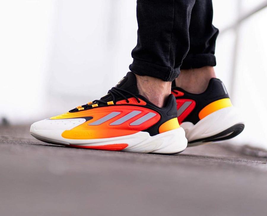 Adidas Ozelia noire jaune et orange on feet (7)