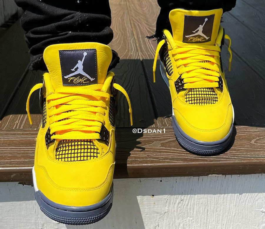 Air Jordan 4 Retro 'Lightning' Tour Yellow 2021 on feet