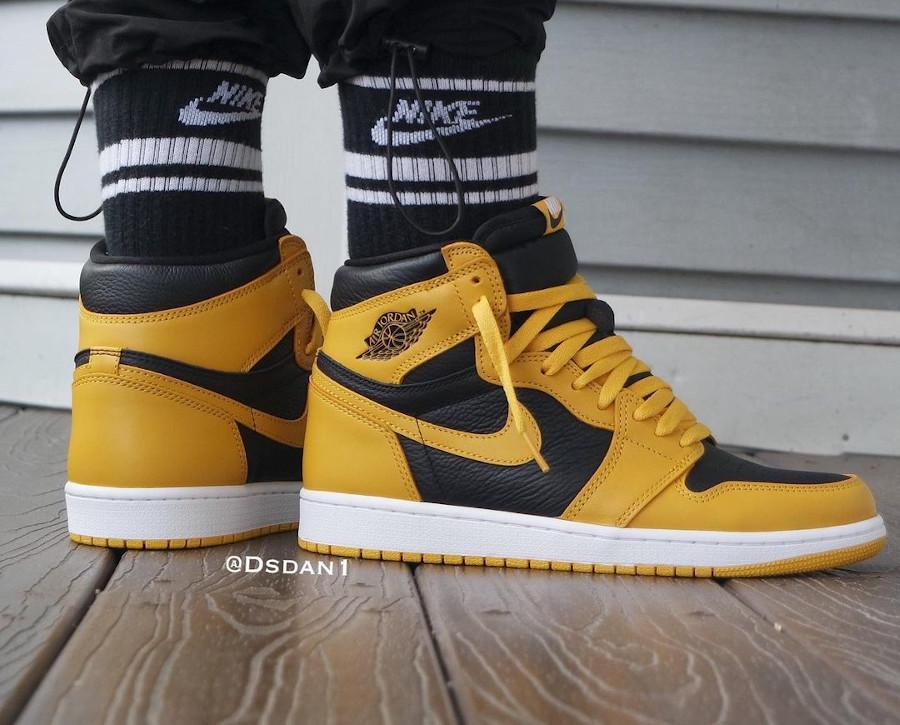 Air Jordan One Hi noire et jaune on feet (2)