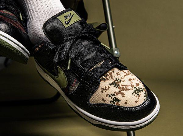 Nike Dunk Low SE camouflage vert noir et orange aux pieds (3)